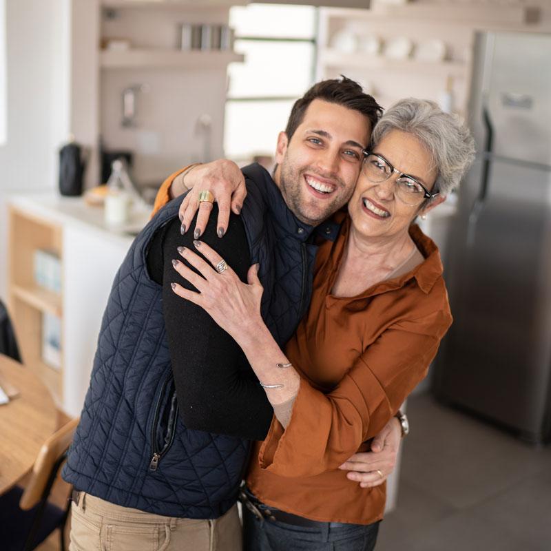senior woman hugging her son
